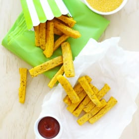 Easy Baked Polenta Fries / Chips Recipe - healthy, vegan, seasoned with dried mixed herbs, nutritional yeast, garlic & onion powder, and a few other yummy ingredients. #polenta #chips #fries #vegan #healthy #polentachips #polentafries