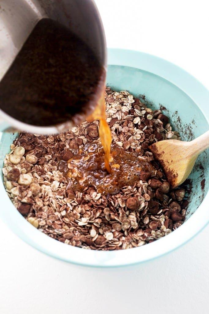 Vegan Chocolate Hazelnut Granola - a delicious dessert granola made with cocoa, praline paste/hazelnut butter and oats. #vegan #glutenfree #chocolate #nutella #hazelnut #granola #recipes #veganrecipes #foodporn #delicious
