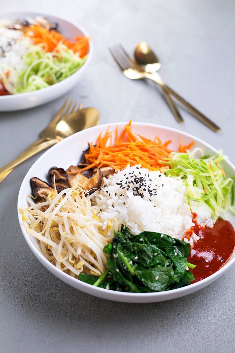 Vegan Korean Bibimbap - a classic Korean dish of rice and seasonal sauteed vegetables, served with a spicy Gochujang chilli sauce. #vegan #korean #bibimbap #veggies #healthy #lowfat #colorful #801010