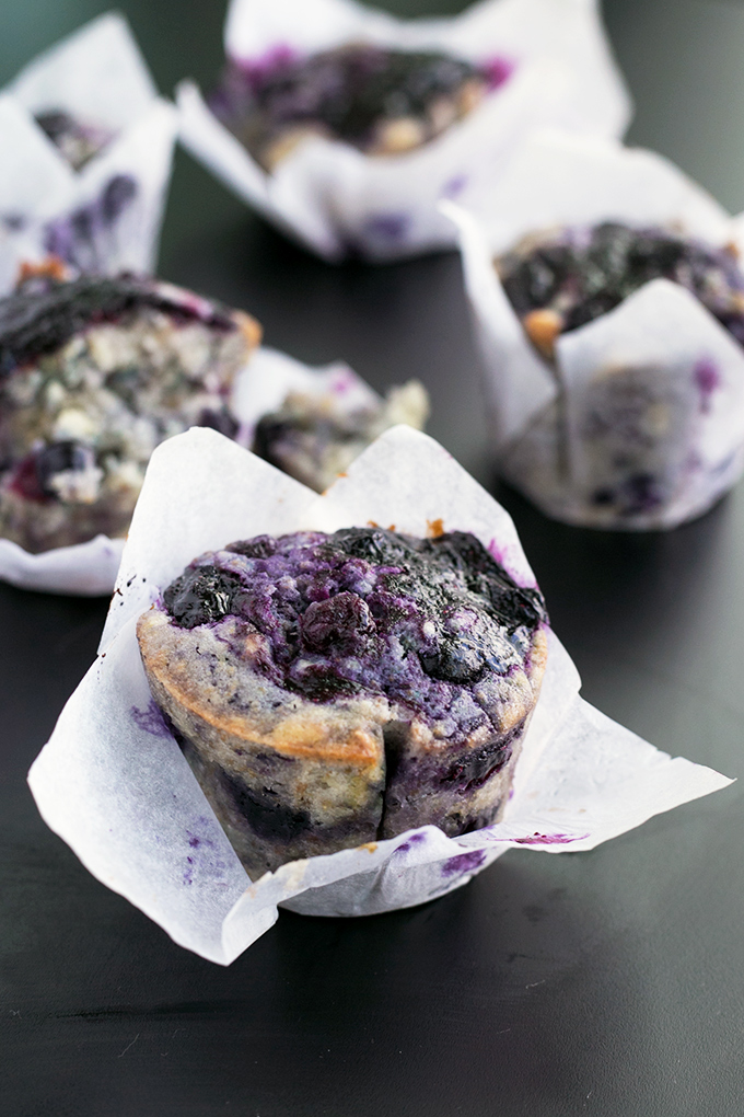 Loaded Vegan Blueberry Muffins - Fully loaded Vegan Blueberry Muffins with a lemon zest topping and homemade Blueberry Jam Swirl. #vegan #muffins #healthy #breakfast #foodporn