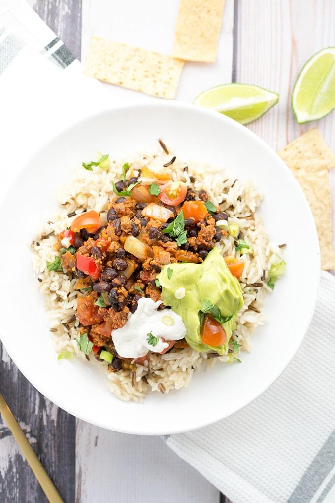 DIY Vegan Burrito Bowl - Rice, Beans, Avocado Lime Sauce and Vegan Sour Cream. #healthy #delicious #burrito #bowl #vegan #simple #easy #avocado