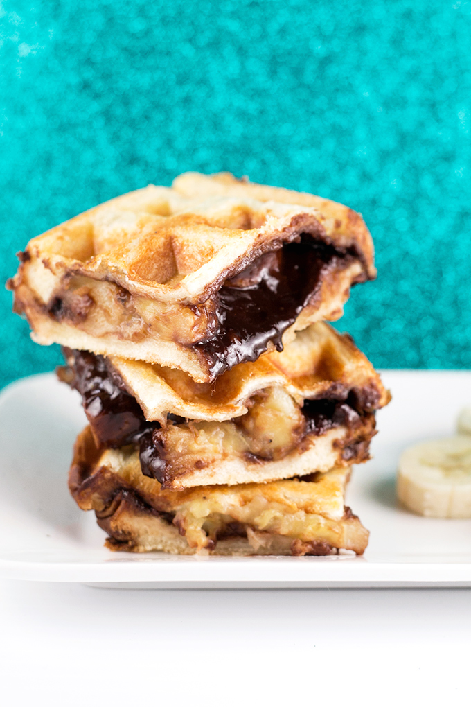 Vegan Waffled Nutella Banana Sandwich - Homemade Vegan Nutella, Banana and Bread pressed in a waffle iron. Simple, Easy, So Sinful. #vegan #nutella #waffled #sandwich #banana #vegetarian #dessert #breakfast