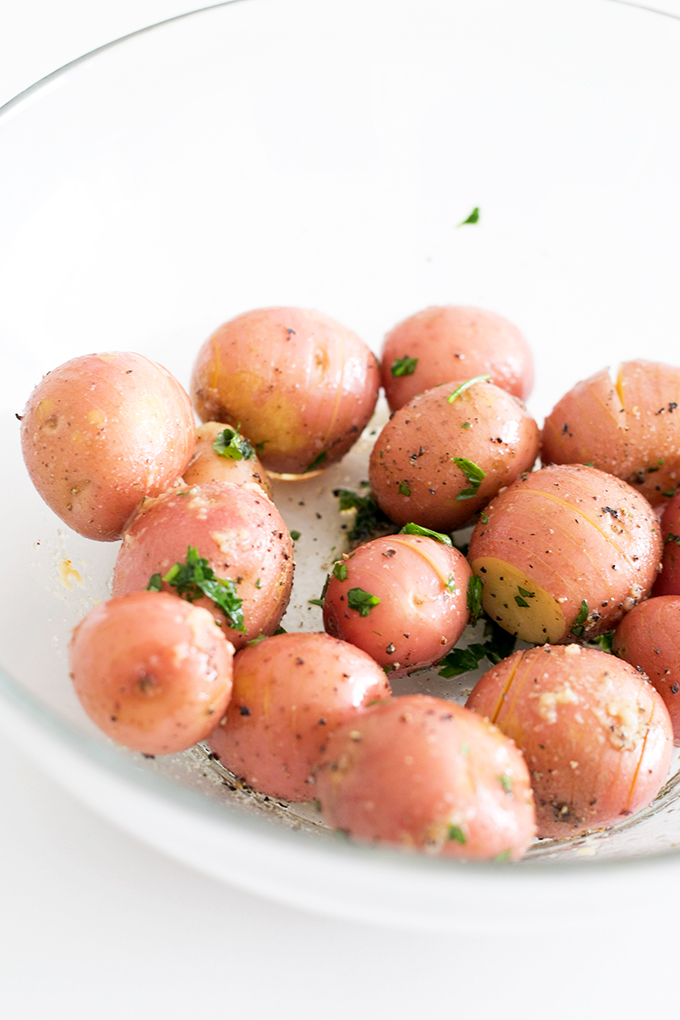Simple Vegan Lemon Garlic Herb Roasted Potatoes - simple to make, only a handful of ingredients, and ready in under an hour.#POTATOES #roasted #herb #lemon #garlic #healthy #vegan #recipes