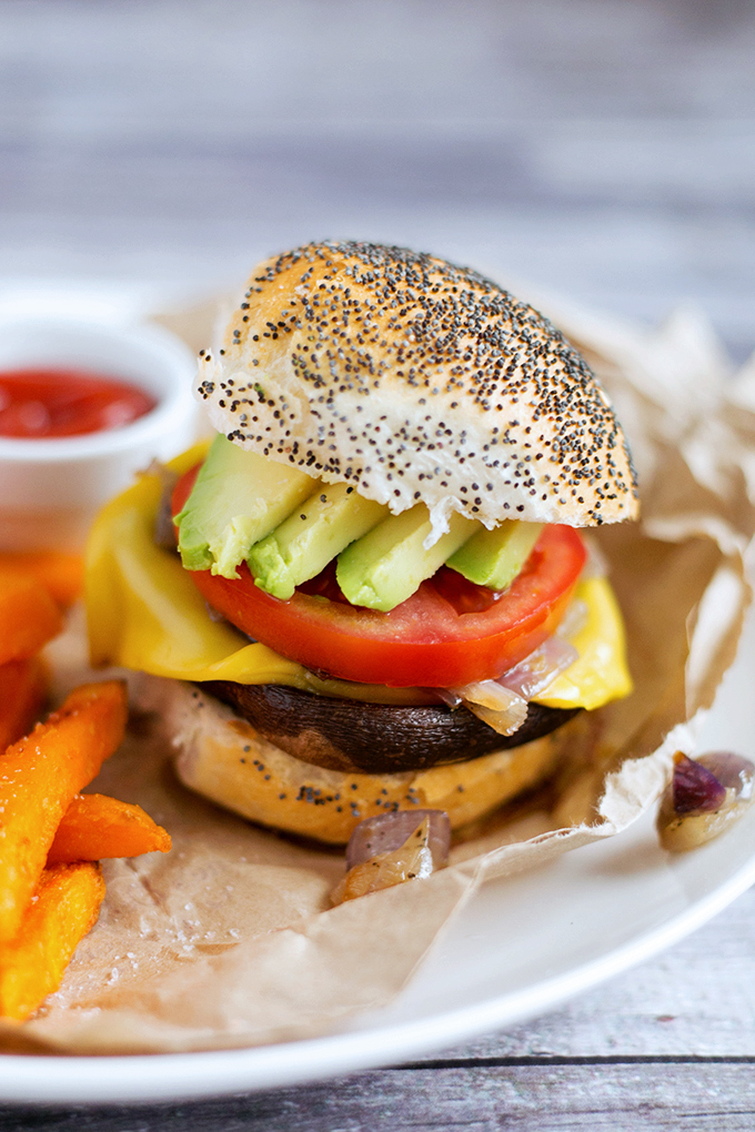 Simple Vegan Portobello Mushroom Burgers with Sweet Onions, Avocado, Tomato and Vegan Cheese. Inexpensive, Simple To Make And Full Of Flavor. #vegan #mushroom #burgers #veganburger #simple #portobellomushroom #recipes