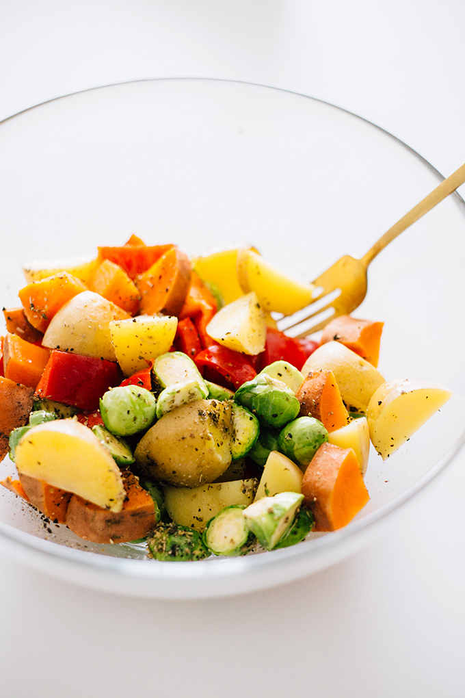 Vegan Roasted Vegetable Salad with Avocado Dressing - Dressed Greens with Roasted Vegetables (Sweet Potato, Potato, Red Bell Pepper and Brussels Sprouts) with a creamy Avocado Dressing.