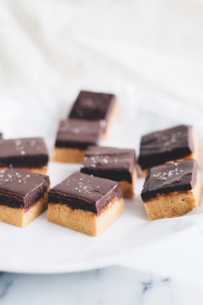 No Bake Vegan Chocolate Peanut Butter Slice - A delicious, rich and creamy treat that doesn't require any baking. Peanut Butter Base and silky Chocolate Ganache Topping. #vegan #vegetarian #dairyfree #peanutbutter #chocolate #bars #easy #simple