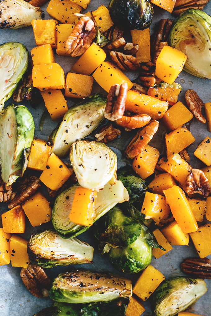 Maple Roasted Brussels Sprouts And Butternut Squash - healthy and delicious holiday side dish. Vegan, Gluten Free, Low in Fat, Easy To Make. #vegan #vegetarian #christmas #maple #brusselssprouts #butternut #squash #veggies #easy #recipe #delicious