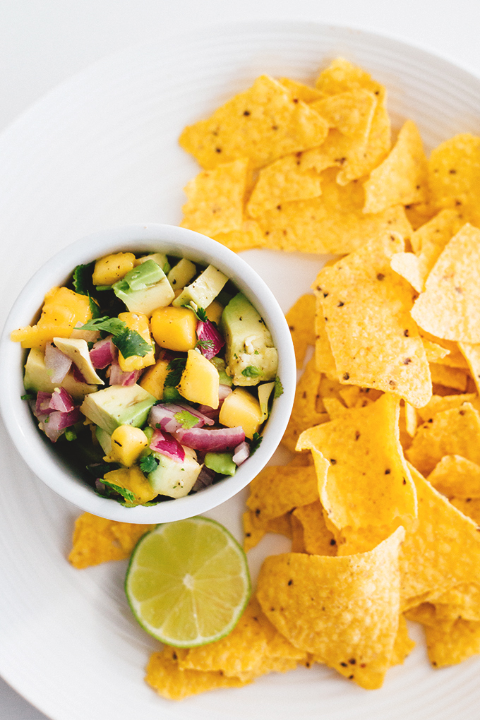 Easy 5 Minute Mango Avocado Salsa with Red Onion, Lime and Jalapeno. Perfect with corn chips or on tacos. #vegan #salsa #mango #avocado #healthy #easy #taco #chips
