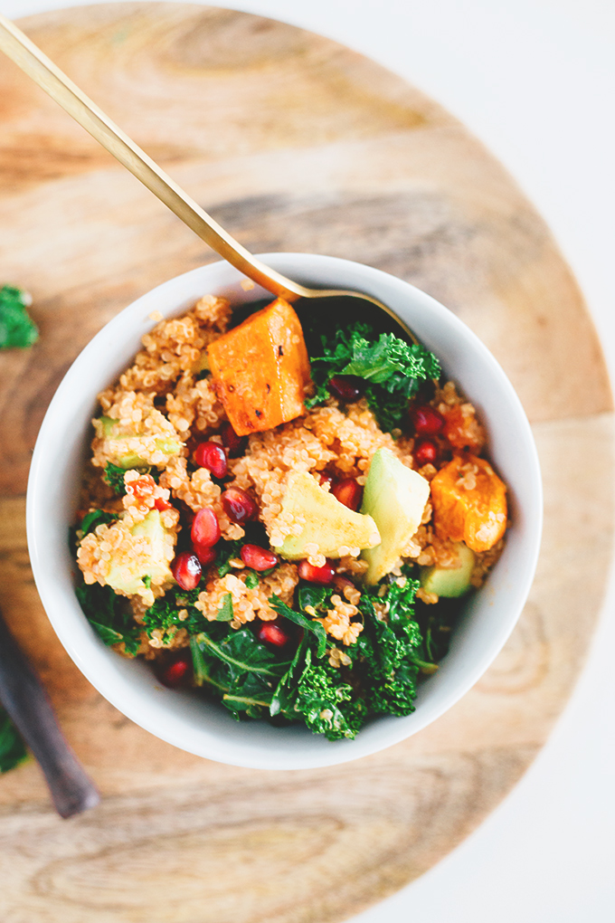 Delicious Detox Vegan Quinoa Salad with Kale and Pomegranate - A great detox recipe after the holiday season. Loaded with Sweet Potato, Kale, Tomato, Pomegranate, Red Onion and and an Orange Paprika Dressing. #vegetarian #healthy #detox #vegan #salad #quinoa