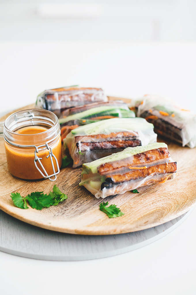 Vegan Teriyaki Tofu Summer Rolls - a healthy, light and low carb Asian inspired dish. Rice Paper Rolls with Teriyaki Baked Tofu, Fresh Veggies and a Spicy Peanut Dipping Sauce. #vegan #teriyaki #tofu #springrolls #summer #rolls #healthy #lowcarb #delicious