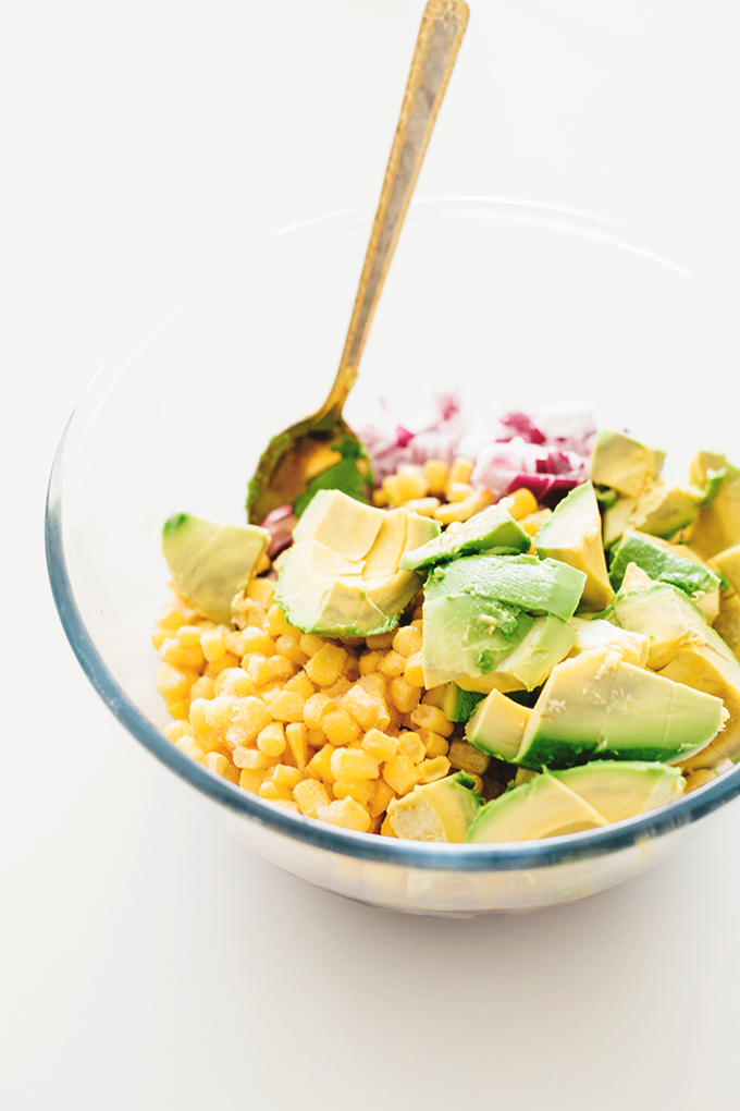 A healthy and delicious Vegan Black Bean Salad with Corn and Avocado In A Tangy Lime Dressing - No-Cook, Full Of Heart Healthy Fat and Loaded With Flavor! #vegan #blackbean #salad #healthy #recipes #vegetarian #corn #delicious
