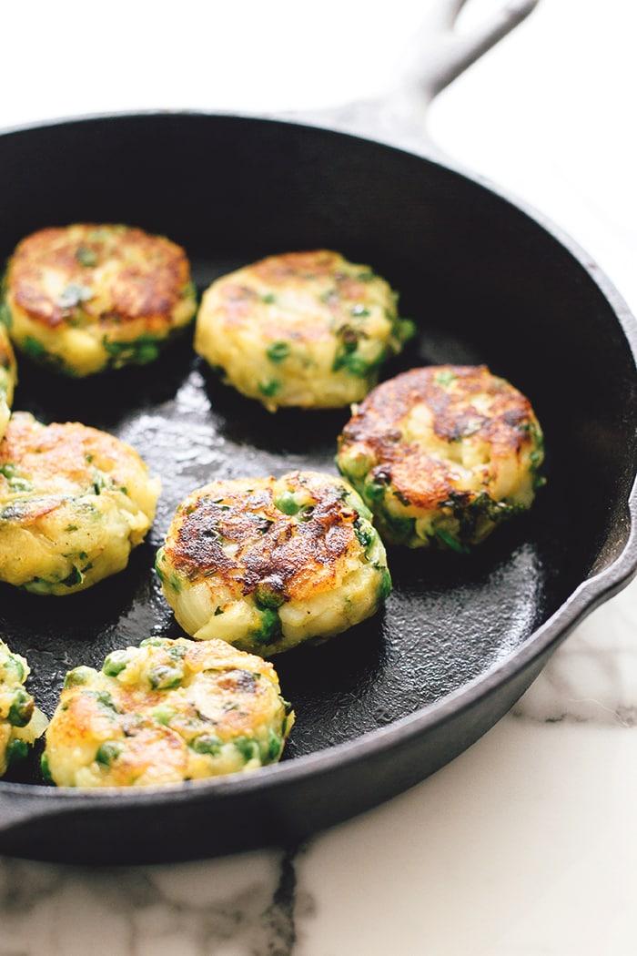 Vegan Aloo Tikki - Spiced Potato Patties with Homemade Coriander Chutney. A Vegan and Gluten Free version of a delicious Indian street snack. #vegan #alootikki #samosa #vegansamosa #indian #potato #healthy #quick #spices #peas #veganrecipes