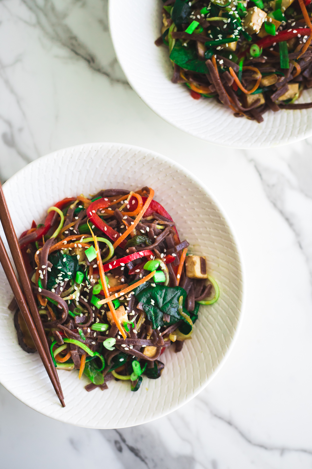 Healthy Vegan Korean Japchae Noodles - A Simple Dish loaded with Vegetables and Zucchini Noodles that is ready in under 30 minutes. #vegan #japchae #korean #noodles #recipe #asian #quick