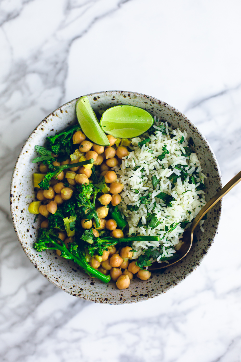 A delicious Quick Turmeric Chickpea Curry with Zingy Cilantro Lime Rice. Vegan, Gluten Free and ready in under 20 minutes. #vegan #turmeric #chickpea #curry #lime #cilantro #rice
