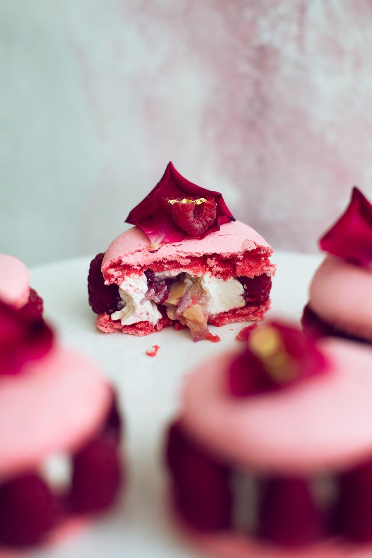The Vegan Ispahan, made with Italian Meringue Vegan Macarons. Rose Shell, White Chocolate Rose Cream, Lychees and Raspberries. Gluten Free. #glutenfree #veganmacaron #ispahan #vegan #macarons #aquafaba #lychee #rose #raspberry