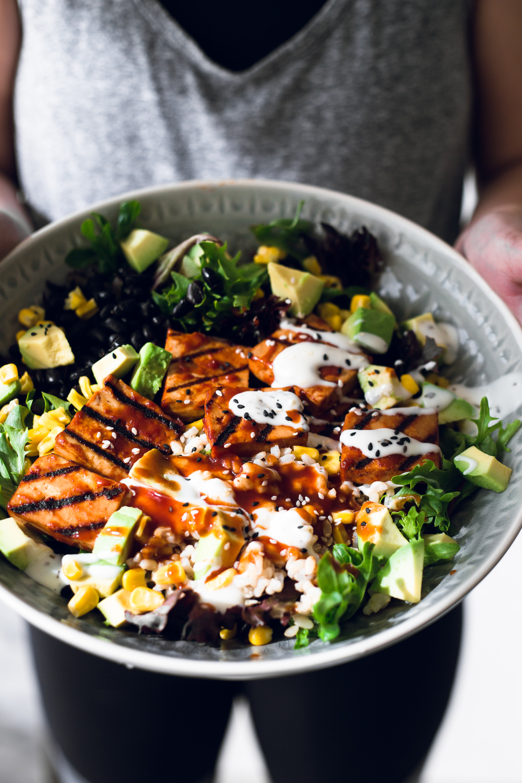 A delicious Vegan Barbecue Bowl loaded with Brown Rice, Avocado, Corn, Black Beans and Smokey Barbecue Tofu. Healthy, delicious, simple. #vegan #bbq #tofu #barbecue #mexican #burritobowl #salad #delicious #healthy #yum