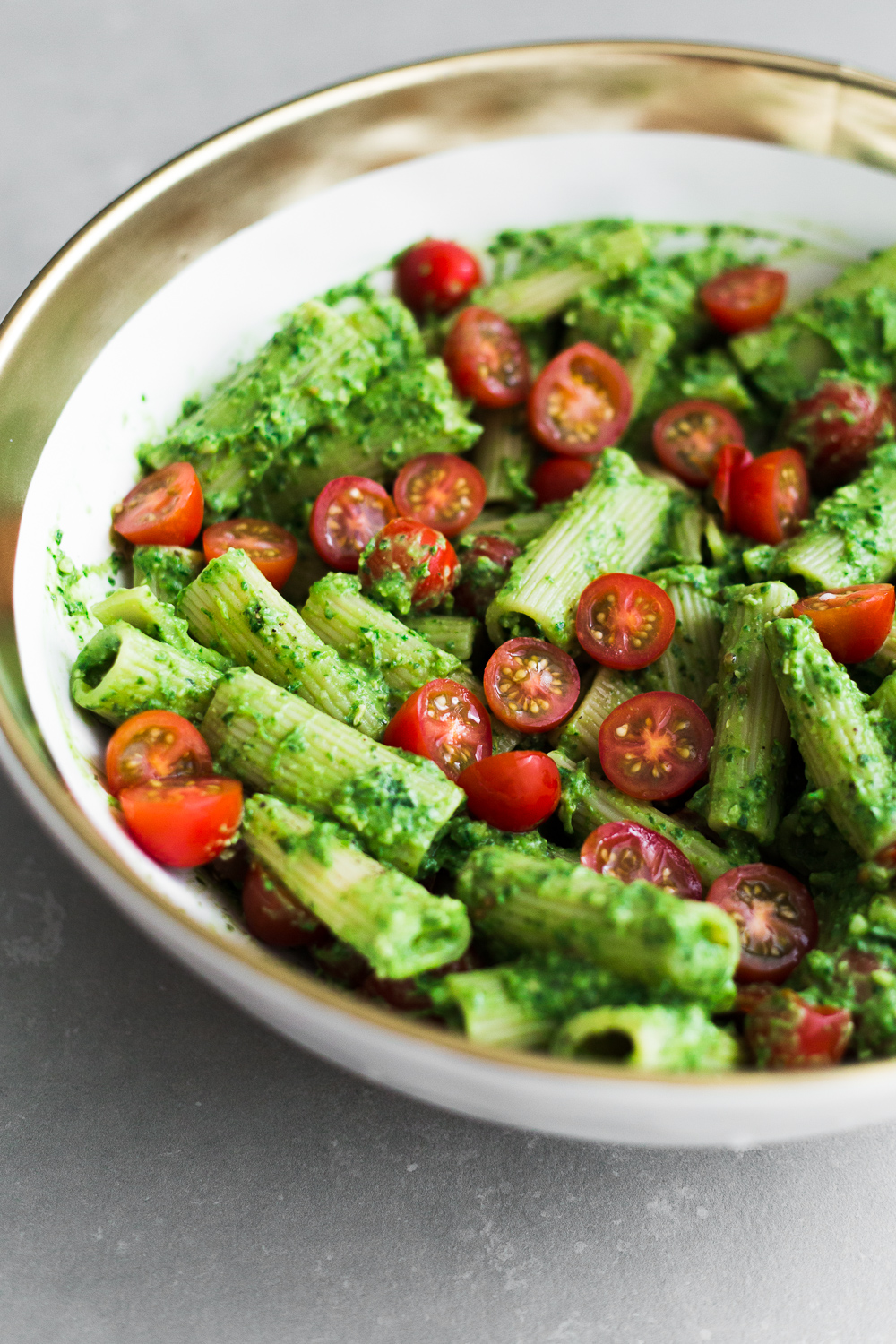 Looking for a quick and simple dinner? Try our this dairy free Avocado Pesto Pasta - ready in under 15 minutes and loaded with bucket fulls of flavor! #vegan #tomato #healthy #avocado #pesto #pasta #simple #quick #pestopasta #dairyfree