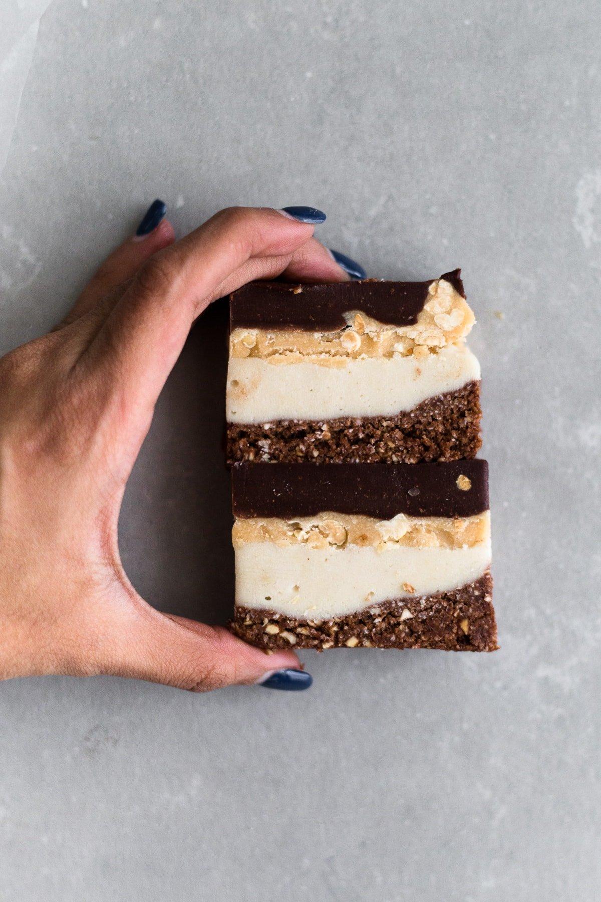 Vegan Snickers Ice Cream Cake. Vanilla Ice Cream base, Caramel Peanut Layer and a lush Chocolate Ganache topping. Dairy Free/Gluten Free/Refined Sugar Free. #vegan #snickers #icecream #chocolate #peanut #peanutbutter #caramel #raw #healthy #sugarfree #simple #nobake