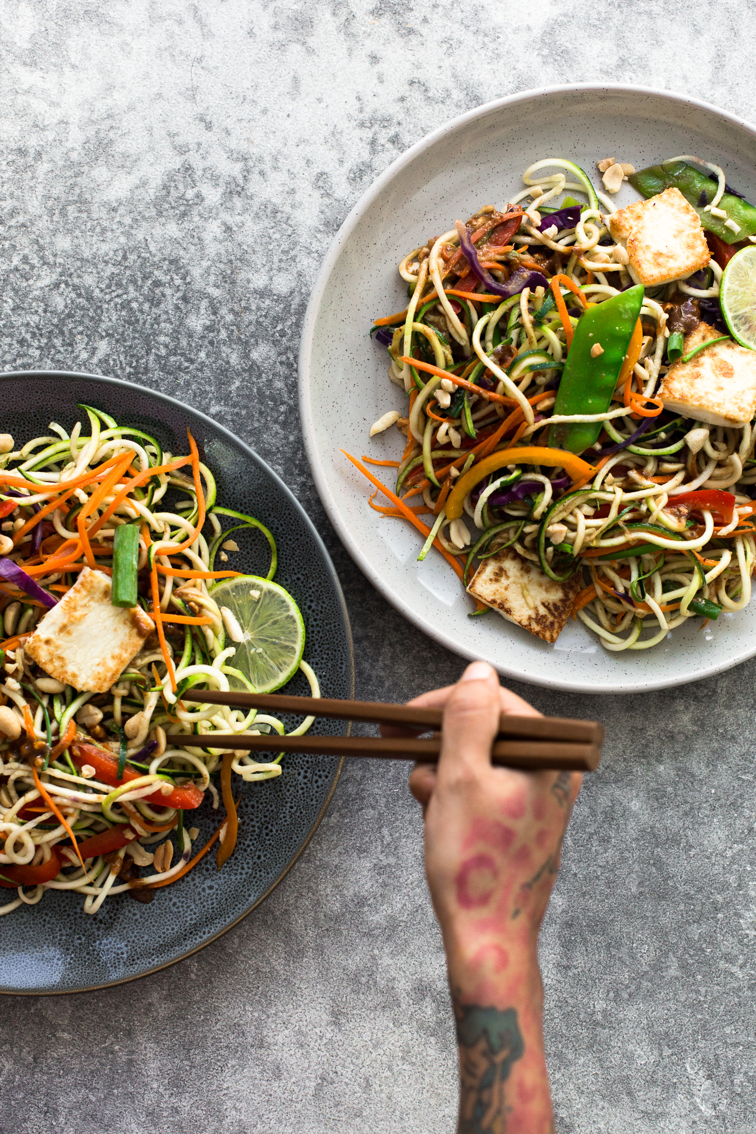 Delicious, healthy and light Asian Rainbow Zucchini Noodles with Crispy Tofu and an Almond Butter Dressing. Vegan, Gluten Free, Ready in Under 25 minutes. #vegan #zucchini #zoodle #padthai #vegetarian #lowcarb #tofu #peppers #healthy #simple #asian #almondbutter #dressing #glutenfree