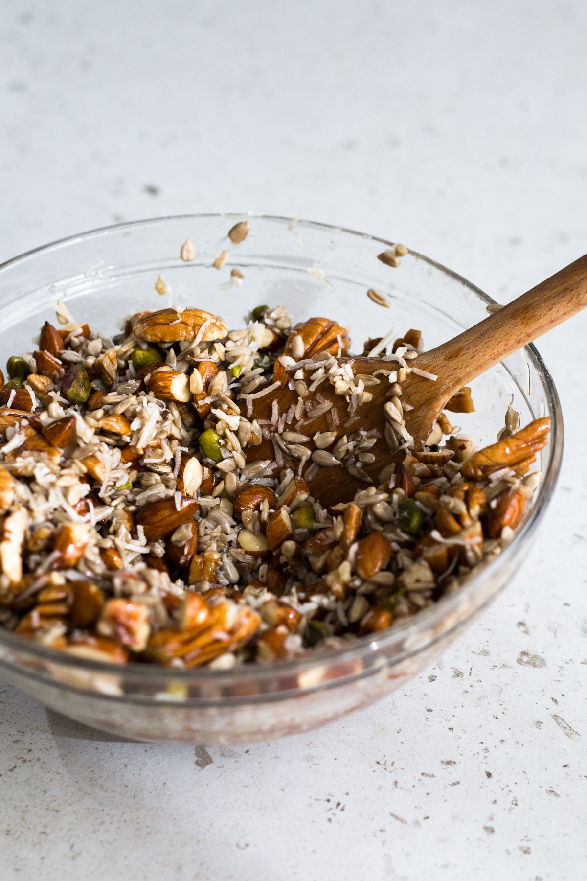 A delicious Grain Free Granola made with Mixed Nuts, Coconut Oil, Vanilla and Orange Zest. Gluten Free, Dairy Free and ready in under 1 hour. #granola #breakfast #cereal #glutenfree #easy #pecan #pistachio #almonds #apricot #cranberry #healthy #sunflowerseeds #breakfastrecipes #brunch