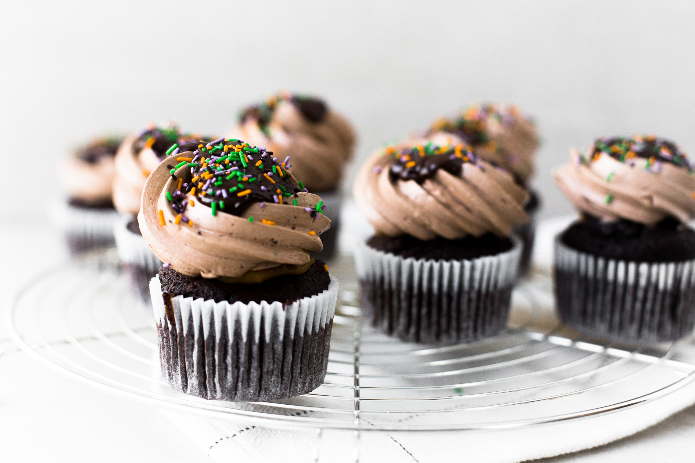 The Ultimate Vegan Chocolate Cupcakes. Tender Chocolate Cake filled with Chocolate Ganache and loaded with Vegan Chocolate Buttercream Frosting. #vegan #chocolate #cupcakes #cake #baking #dairyfree #ganache #buttercream #veganbaking #plantbased