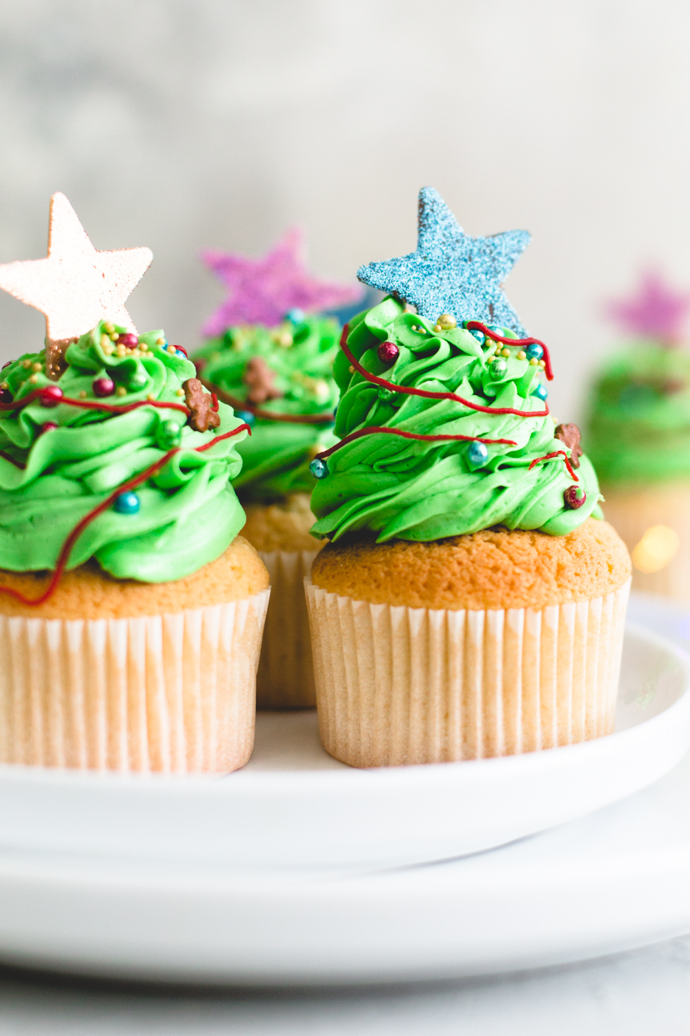 Tender and delicious Vegan Vanilla Cupcakes that everyone will love. Iced with Vanilla Buttercream Frosting and perfect for birthdays. #vegan #cupcakes #dessert #cake #vegancupcakes #vanilla #christmas #xmas #holidays #baking #veganbaking