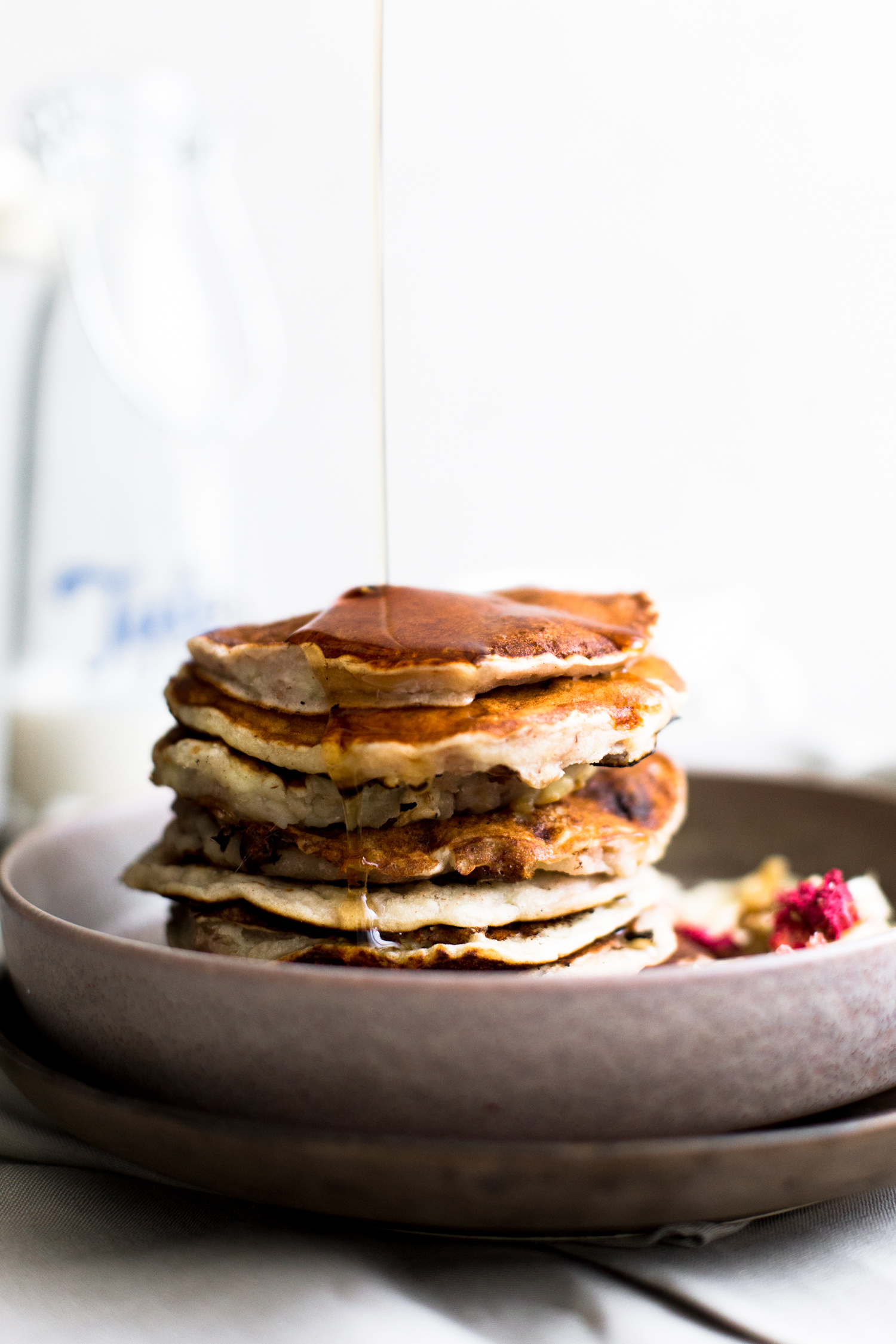 Vegan Banana Nut Pancakes - like Banana Bread but in Pancake form. Serve with lashings of Maple Syrup and Vegan Butter. Ready in under 15 minutes. #pancakes #vegan #banana #nut #bananabread #breakfast #brunch #easy #simple #dessert #vegetarian #vegan #veganpancakes