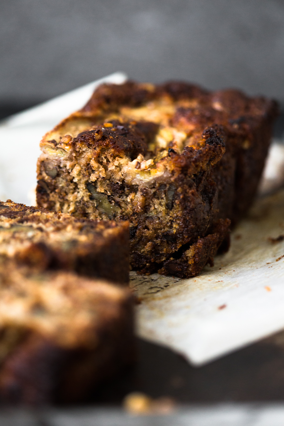 A delicious Vegan Banana Bread recipe loaded with Walnuts, Dark Chocolate and a Brown Sugar Cinnamon Swirl in the middle. Ready in under 1 hour. #bananabread #vegan #cinnamon #cinnamonswirl #quickbread #bananamuffins #veganbaking #veganbananabread #easy #simple #walnuts #chocolate #eggless #baking #dessert #breakfast