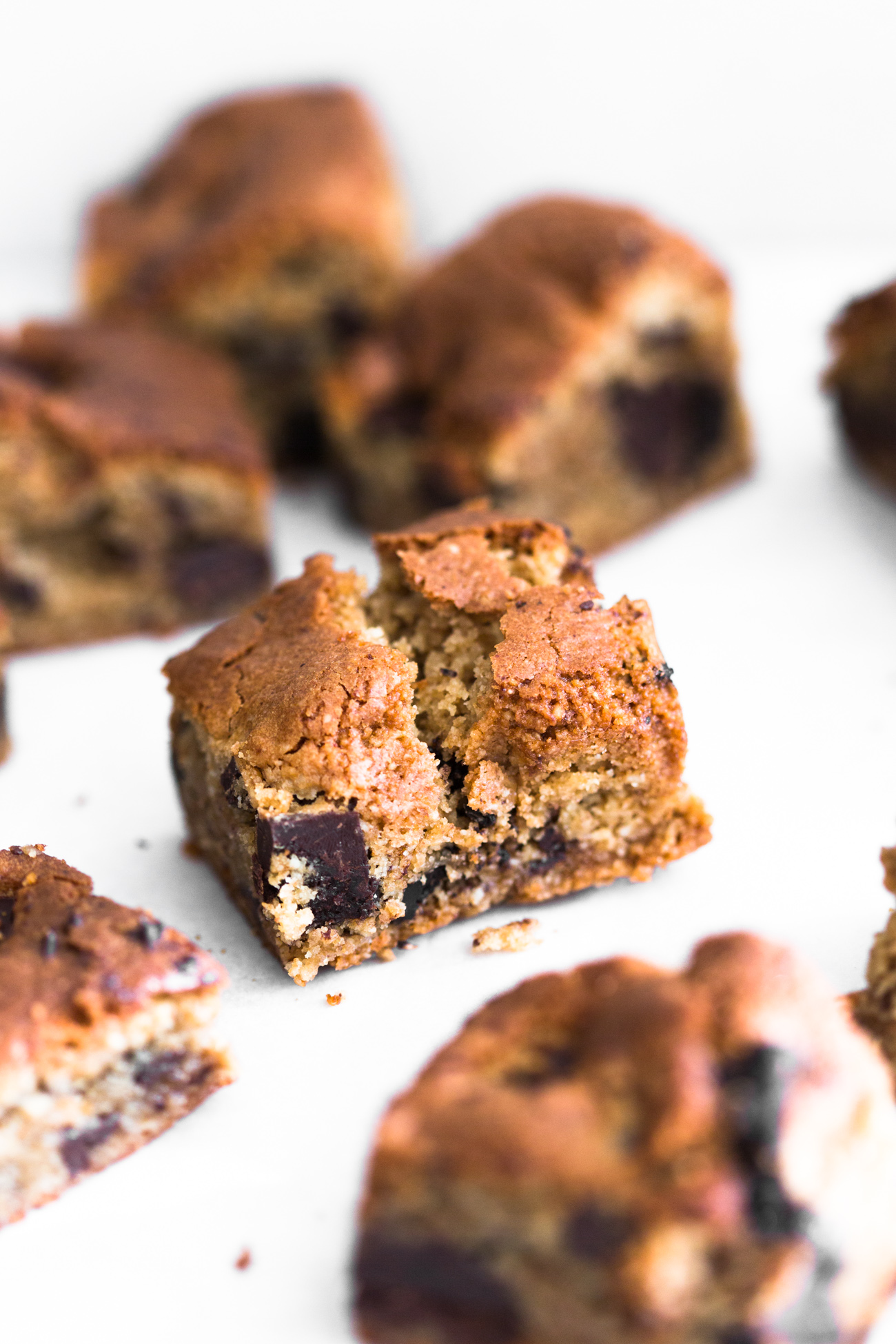 Sweet meets salty in these Vegan Miso Chocolate Chip Cookie Bars. Don't knock it till you try it! Ready in under an hour and 100% Gluten Free. #miso #glutenfree #chocolatechip #blondies #chocolatechunk #misochocolate #salty #baking #vegan #cookiebar #almonds #dairyfree