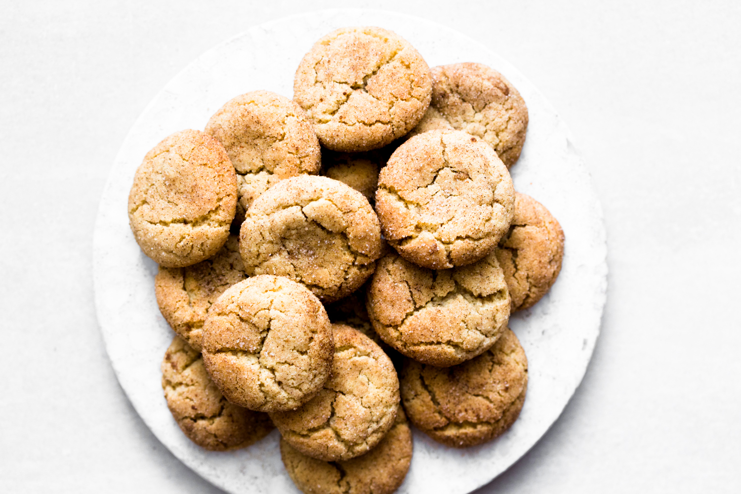 Delicious Vegan Snickerdoodles that are chewy, coated in liberal amounts of cinnamon sugar and ready in under 1 hour. Guaranteed to give you a hard on. #cookies #snickerdoodle #vegansnickerdoodles #vegancookies #snickerdoodles #recipe #soft #dairyfree #baking #easy #simple #eggless