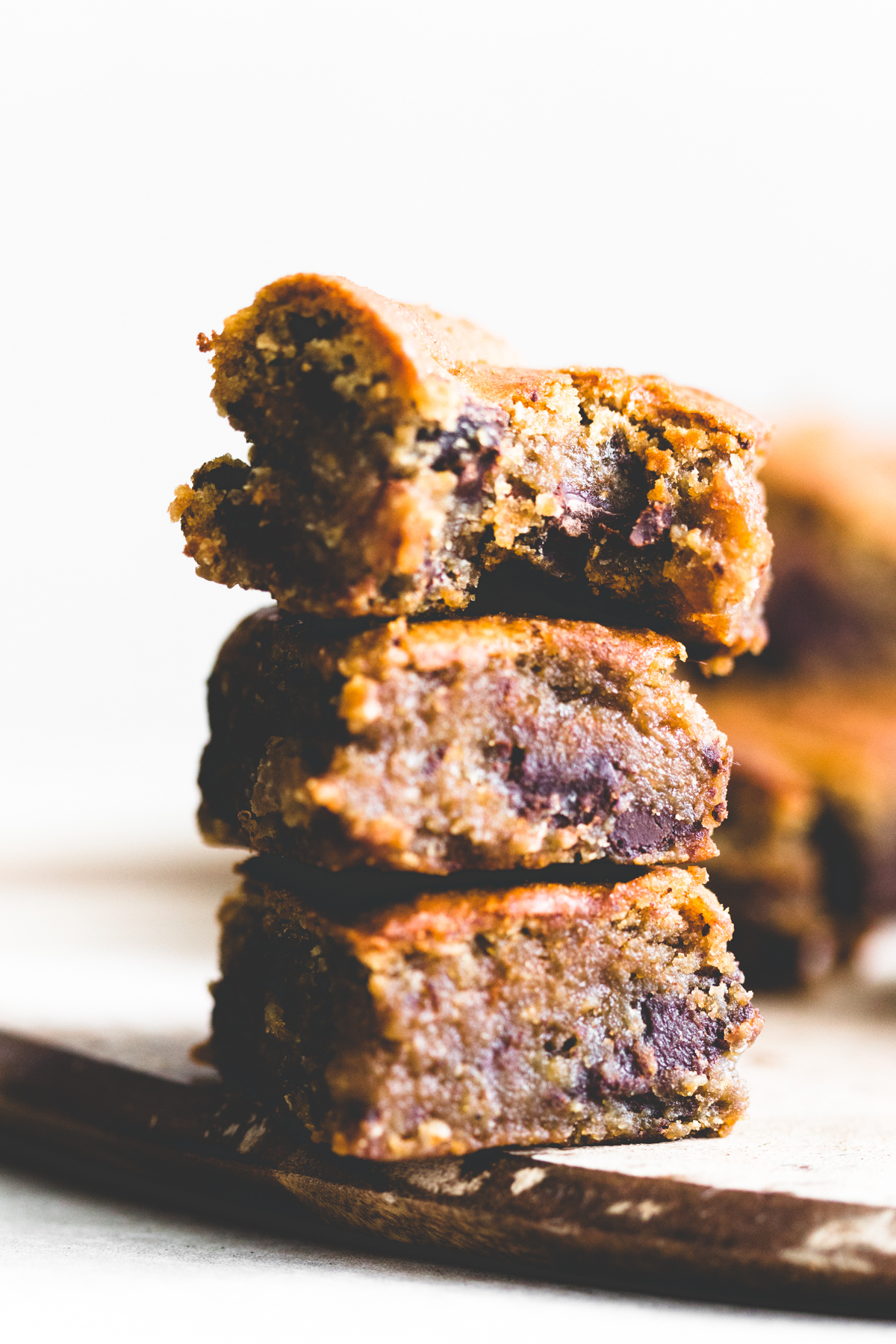 Healthy and delicious chewy Vegan Chickpea Blondies with Chocolate Chunks. You won't even know that they're made with Garbanzo Beans! #chickpea #blondies #vegan #healthy #chickpeablondies #brownies #veganbaking #healthyvegan #chocolatechipcookie #chocolate #cookiebars #refinedsugarfree #glutenfree #baking